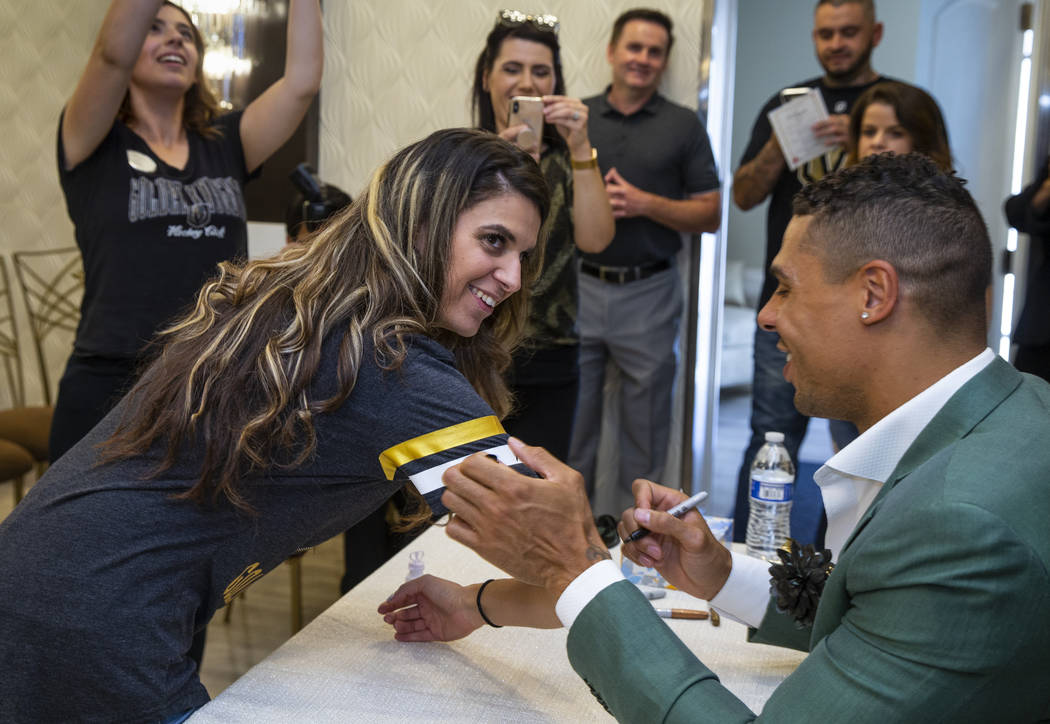 Vegas Golden Knights player Ryan Reaves autographs the shirt of guest Ashley Obermeyer after co ...