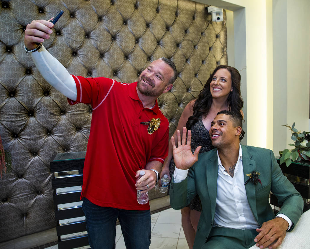 (From left) Justin and Laura Long join Vegas Golden Knights player Ryan Reaves in a quick messa ...