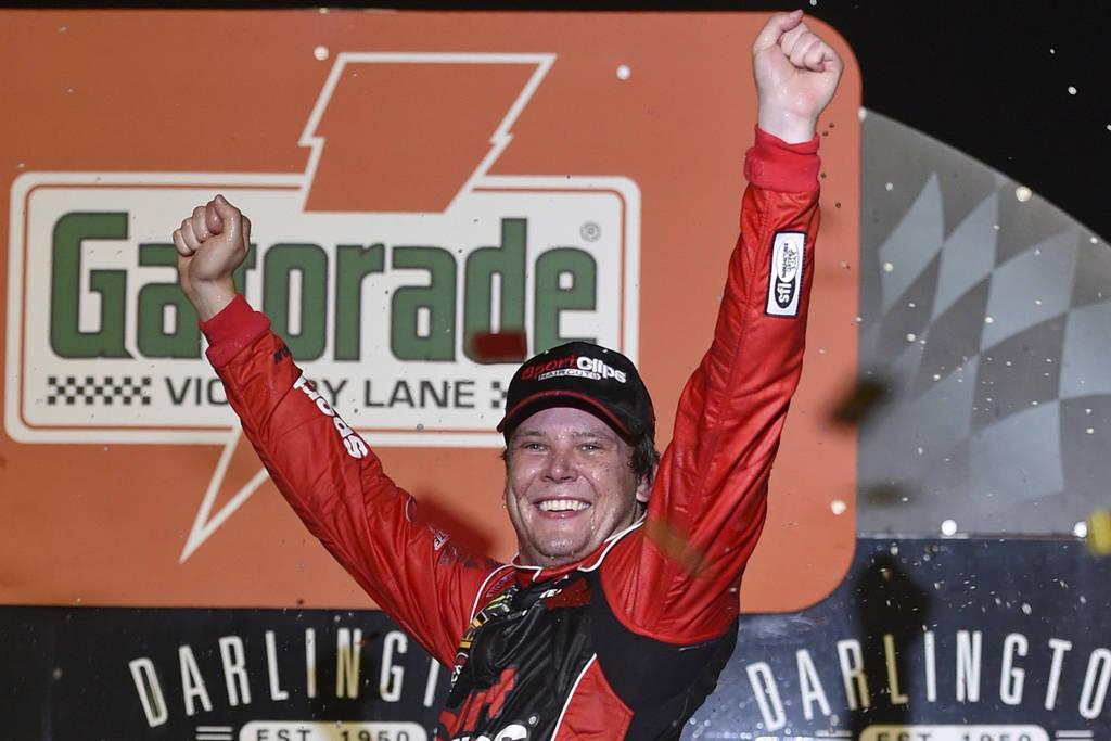 Erik Jones celebrates his victory after a NASCAR Cup Series auto race on Sunday, Sept. 1, 2019, ...