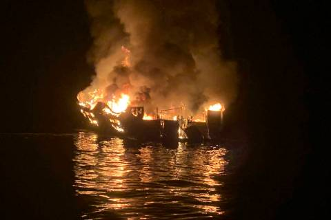 In this photo provided by the Santa Barbara County Fire Department a dive boat is engulfed in f ...
