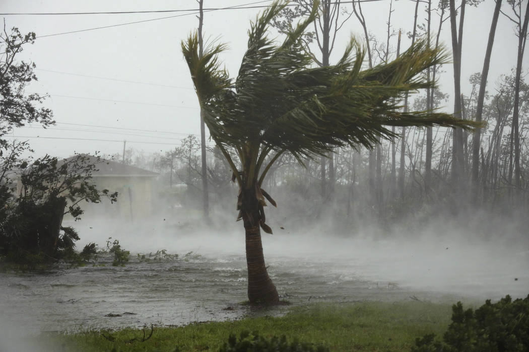 A road is flooded during the passing of Hurricane Dorian in Freeport, Grand Bahama, Bahamas, Mo ...