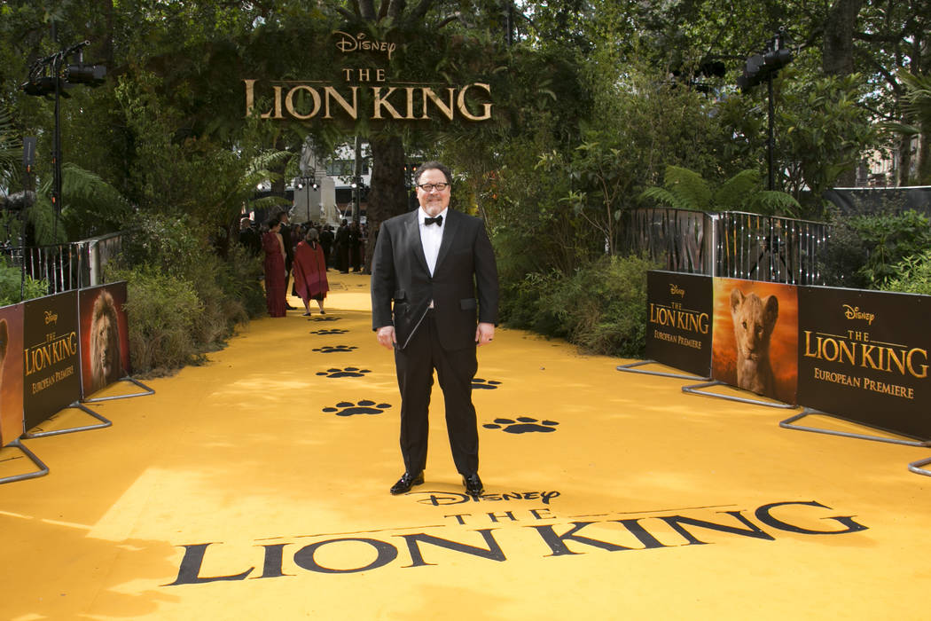 FILE - In this July 14, 2019 file photo, director Jon Favreau poses for photographers upon arri ...