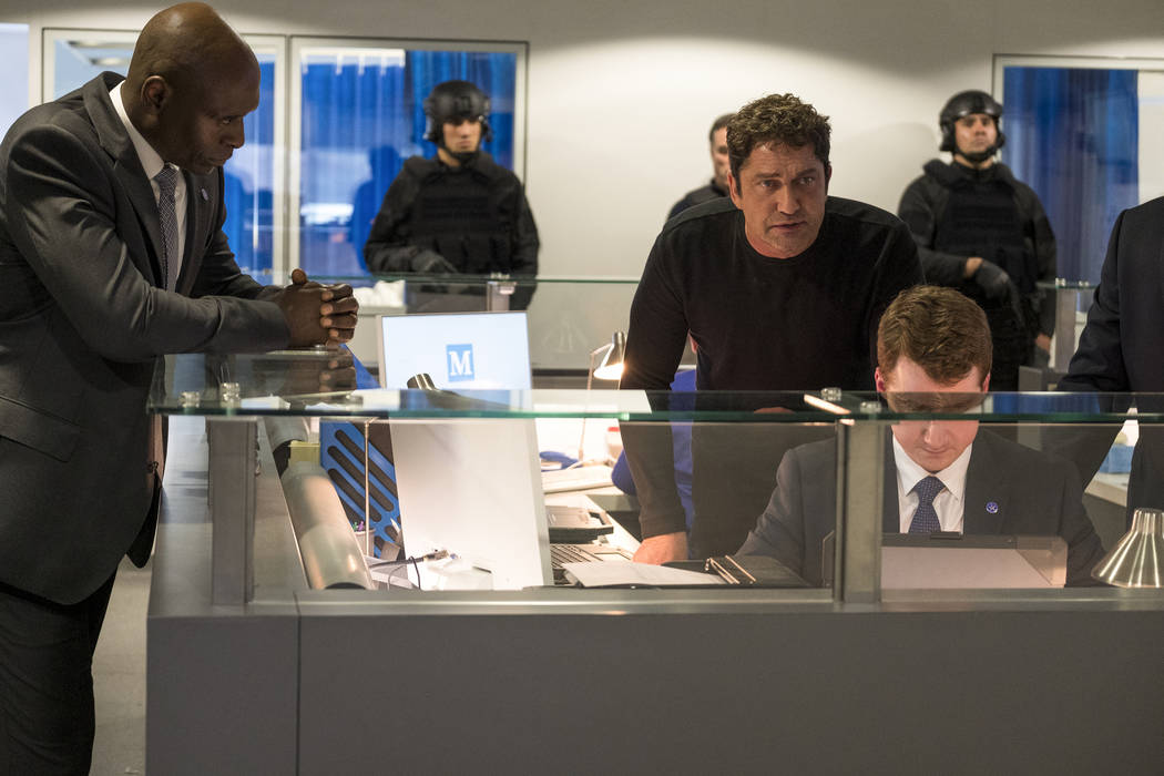 """This image released by Lionsgate shows Lance Reddick, left, and Gerard Butler in """"Angel Ha ..."""