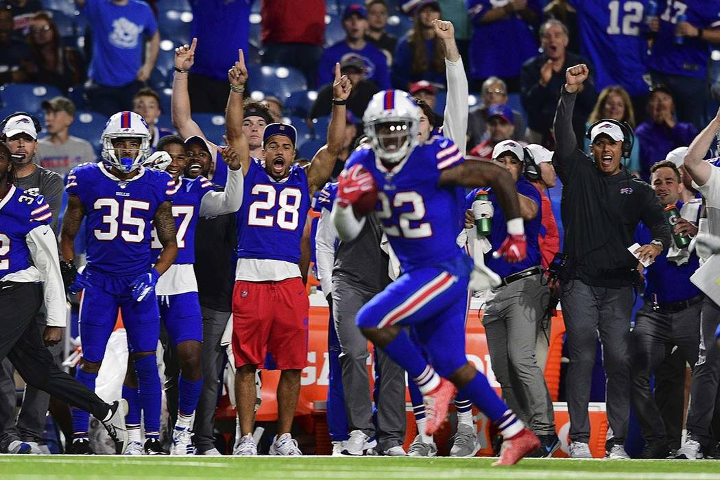 Buffalo Bills running back Marcus Murphy (22) heads for the end zone for a touchdown during the ...