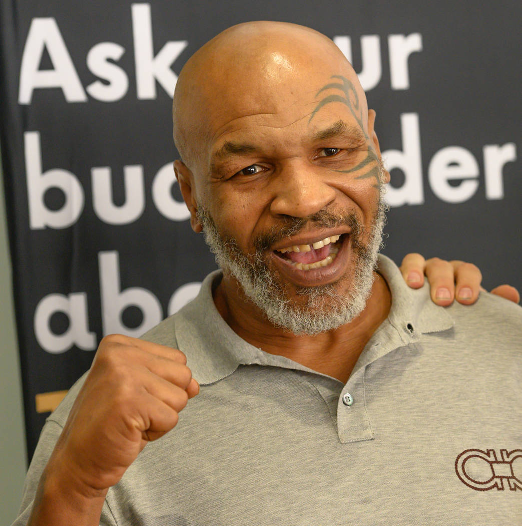 Mike Tyson is shown greeting fans at the Source cannabis dispensary in Henderson on Saturday, A ...