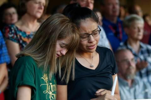 High School students Celeste Lujan, left, and Yasmin Natera mourn their friend Leila Hernandez, ...