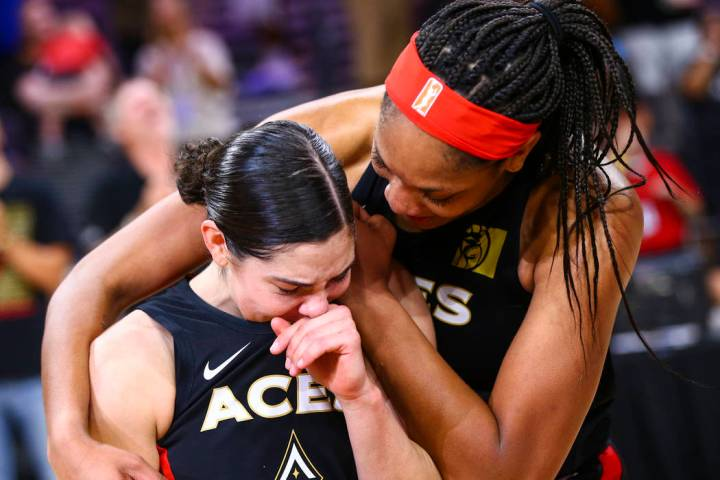 Las Vegas Aces' A'ja Wilson, right, comforts Kelsey Plum after their win against the Los Angele ...