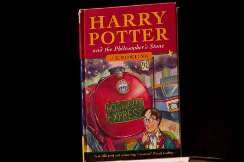 """This May 20, 2013, file photo shows a first edition copy of the first Harry Potter book """"Harry ..."""