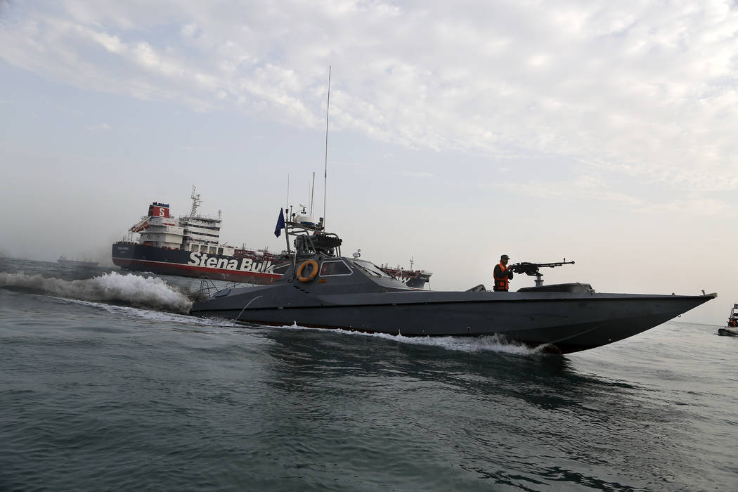 In a July 21, 2019, file photo, a speedboat of the Iran's Revolutionary Guard moves around a Br ...