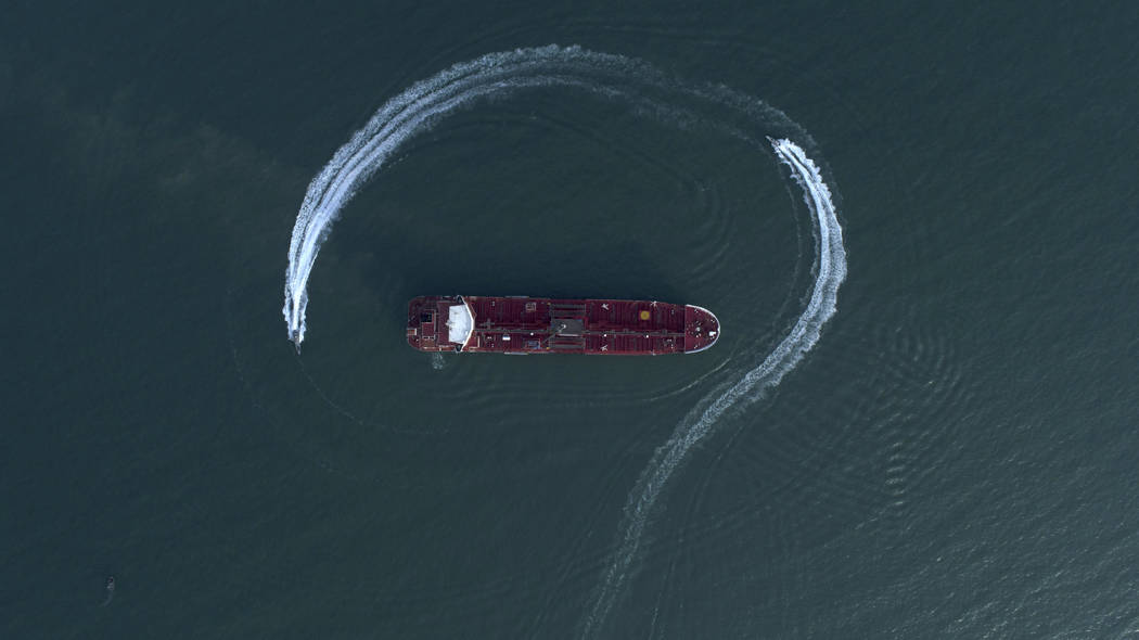A July 21, 2019, file photo, an aerial view shows a speedboat of Iran's Revolutionary Guard mov ...