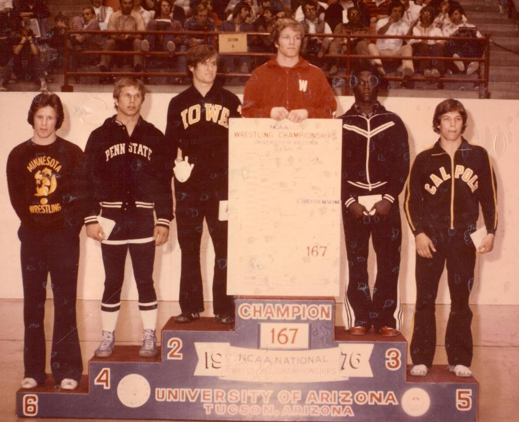 Pat Christenson holds the bracket after winning the 1976 NCAA wrestling 167-pound championship ...