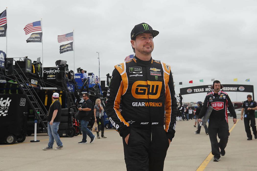 Kurt Busch walks to the garage to start practice for a NASCAR Cup Series auto race at Texas Mot ...