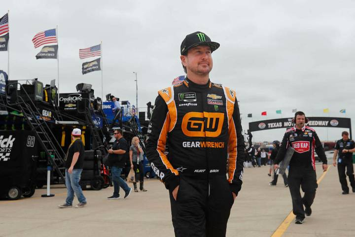 Kurt Busch walks to the garage to start practice for a NASCAR Cup Series auto race at Texas Mot ...