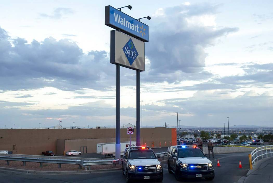In an Aug. 3, 2019, photo Texas state police cars block the access to the Walmart store in the ...