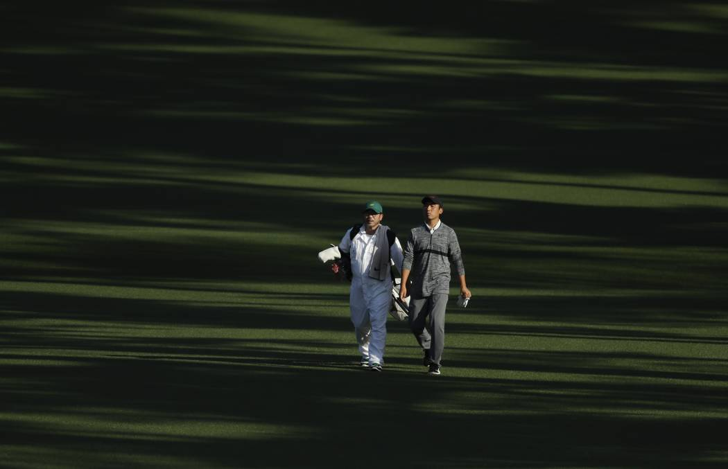 Doug Ghim walks down the second fairway during the second round at the Masters golf tournament ...