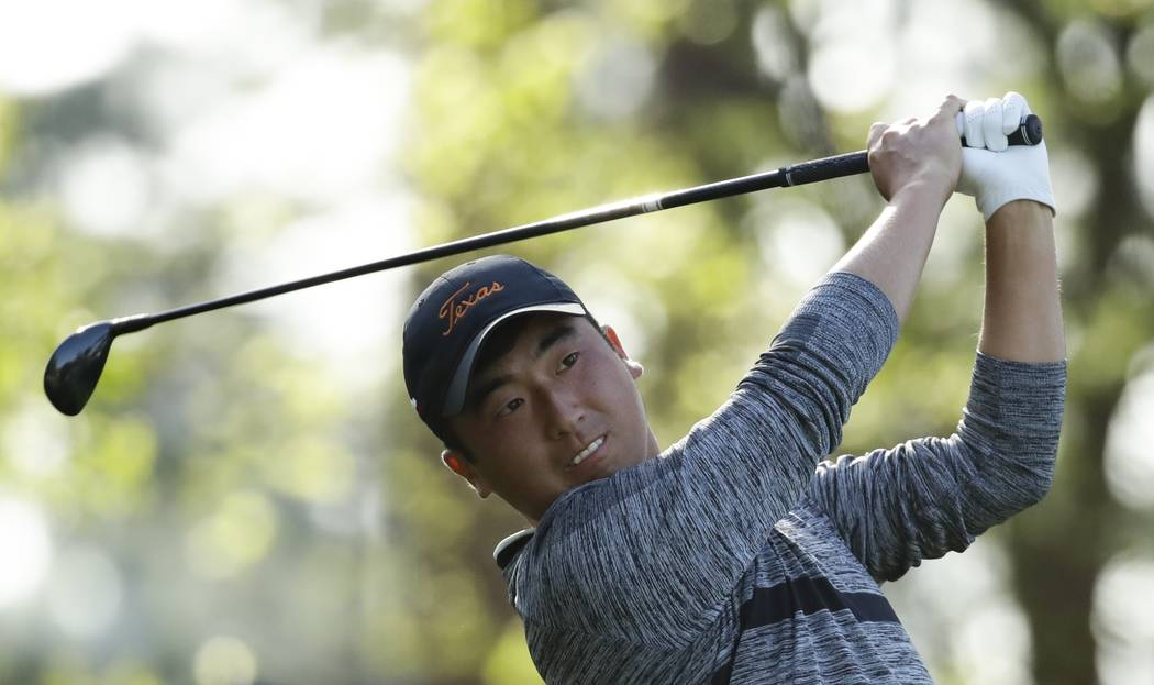 Doug Ghim hits on the fourth tee during the second round at the Masters golf tournament Friday, ...