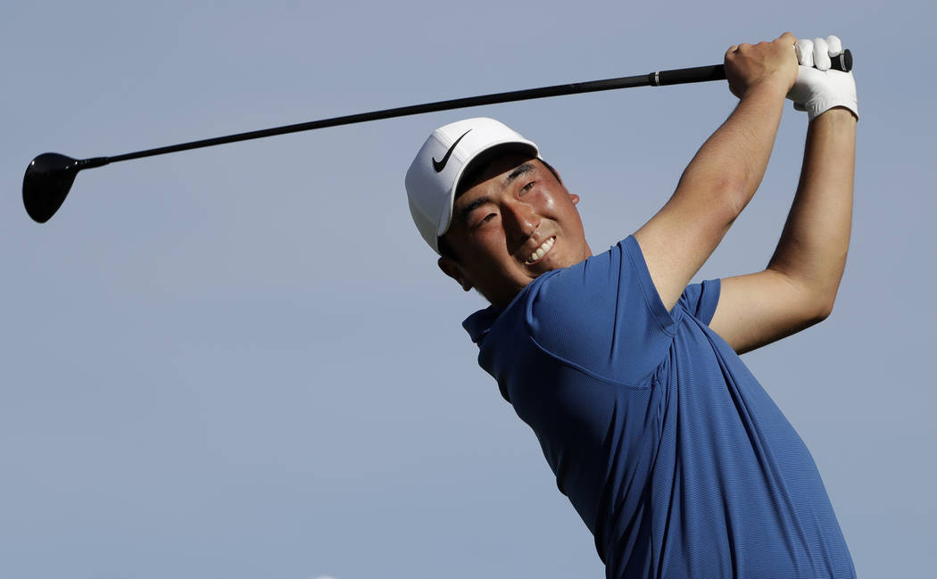 Doug Ghim watches his tee shot on the second hole of the South Course at Torrey Pines Golf Cour ...