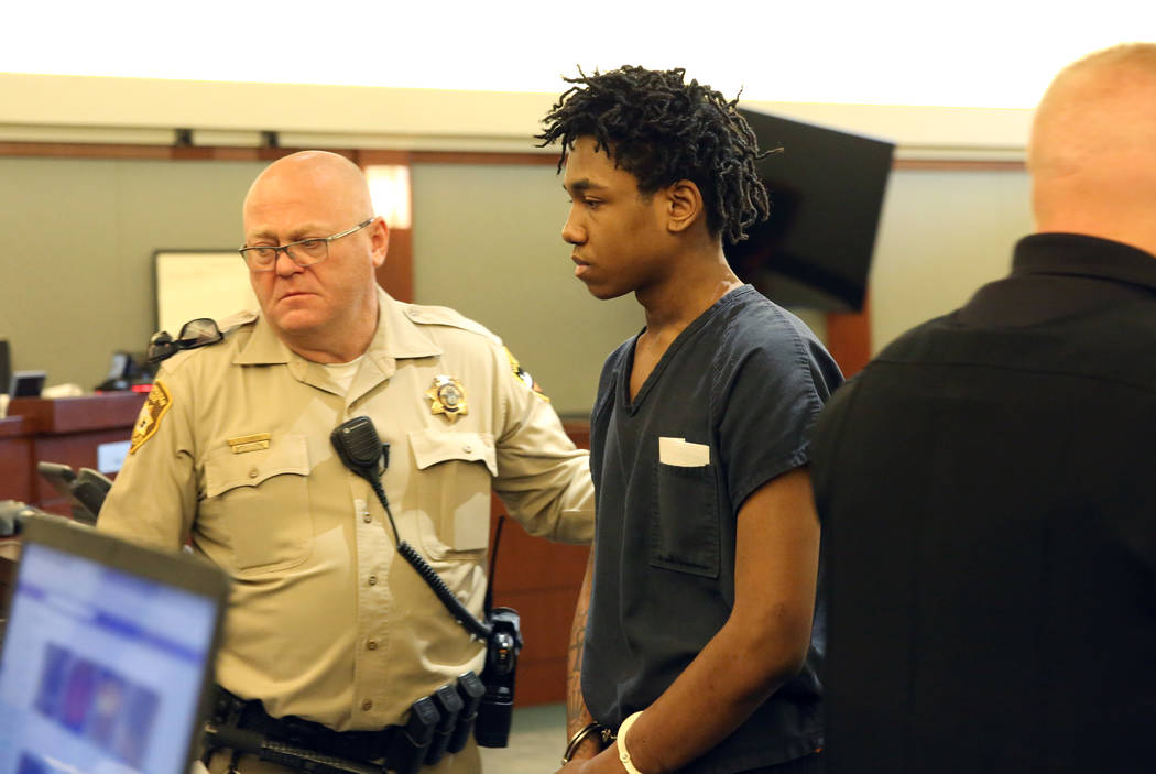 Damion Dill, accused of killing 11-year-old Angelina Erives, led out of the courtroom after his ...