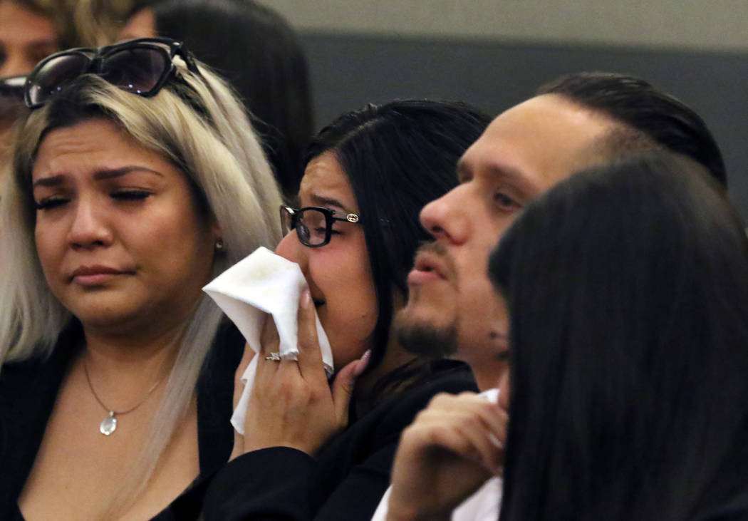 Anabel Sarabia, center, and her husband Alberto, right, parents of shooting victim 11-year-old ...