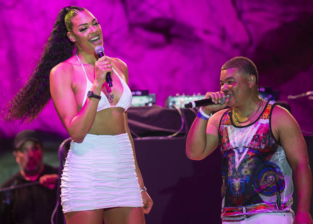 Las Vegas Aces center Liz Cambage, left, briefly walks on stage at Mandalay Bay Beach on Friday ...