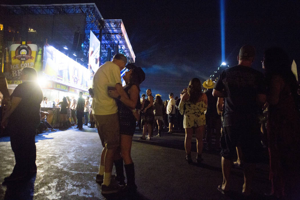 A couple slow dances while Chris Young performs during the second night of Route 91 Harvest cou ...