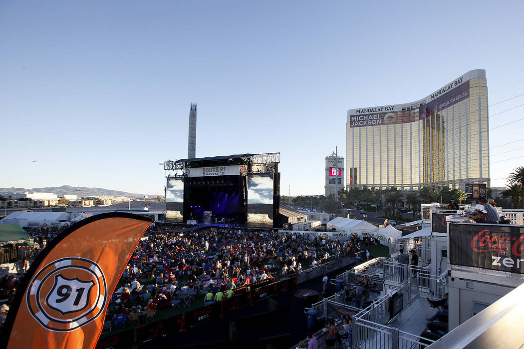 Fans listen to Dustin Lynch perform at the Route 91 Harvest country music festival at the MGM R ...