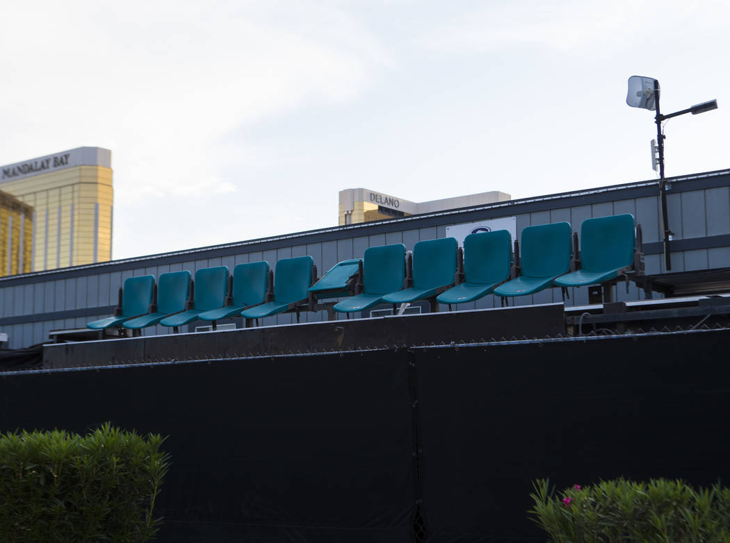 Chairs sit by a fence at the former Route 91 Harvest music festival site in Las Vegas on Tuesda ...