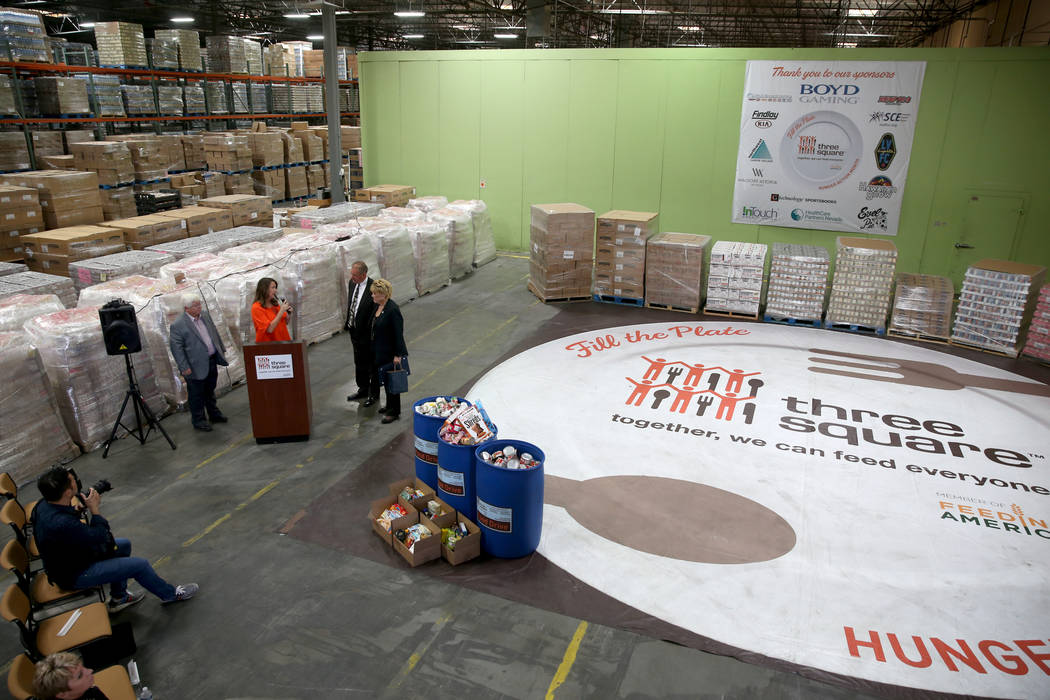 Three Square Food Bank Chief Development Officer Michelle Beck, second from left, thanks, from ...