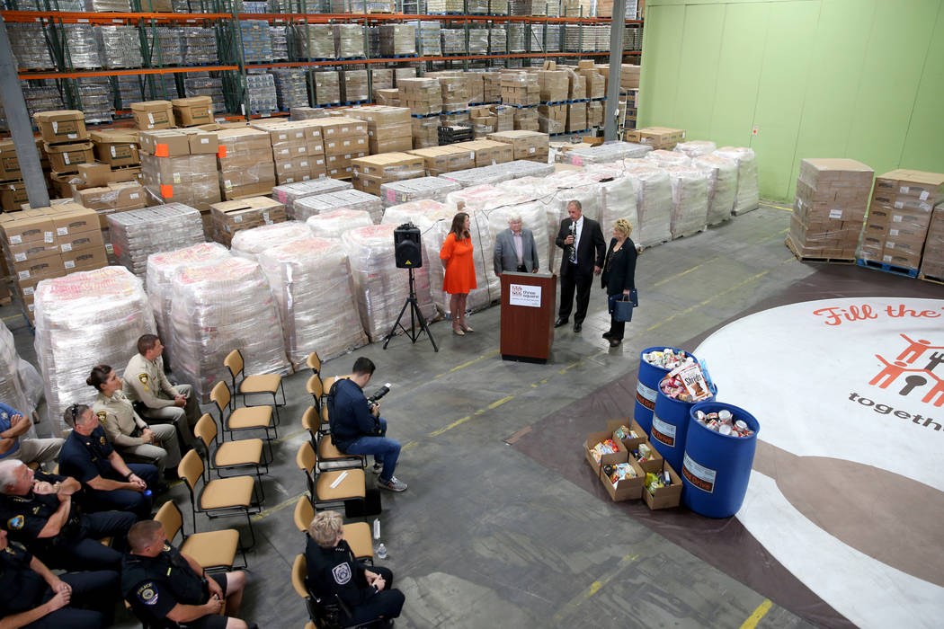 Three Square Food Bank Chief Development Officer Michelle Beck, from left, Boulder City Mayor K ...
