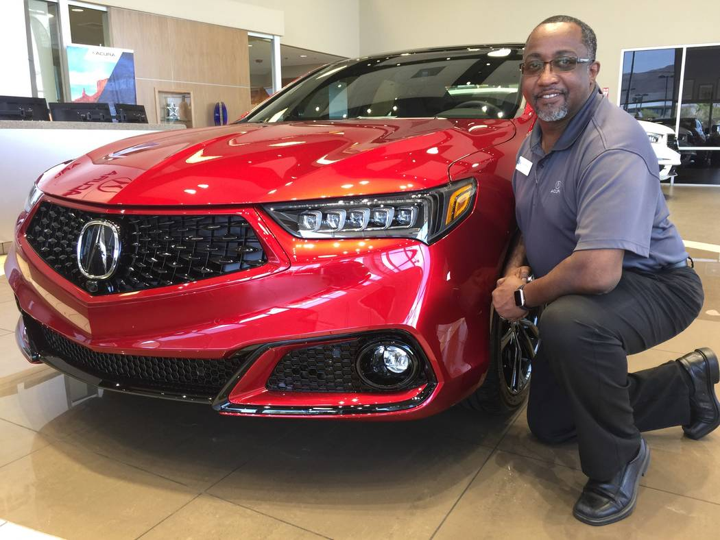 Veteran sales manager John Williams is seen with the 2020 Acura TLX PMC Edition at Findlay Acur ...