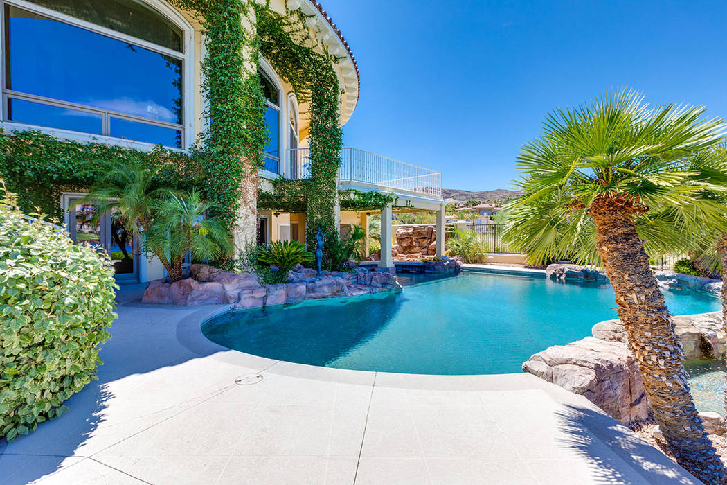 The pool curves around the backyard patio. (Ivan Sher Group)