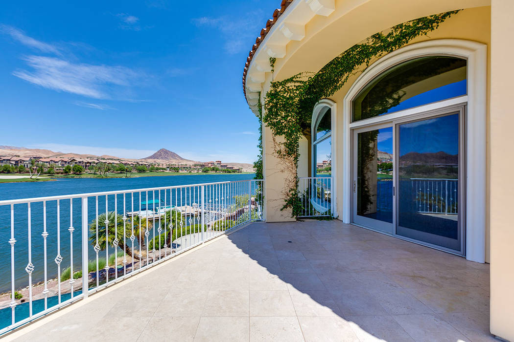 The upstairs, suite-sized master bedroom has a balcony with views of Lake Las Vegas. (Ivan Sher ...