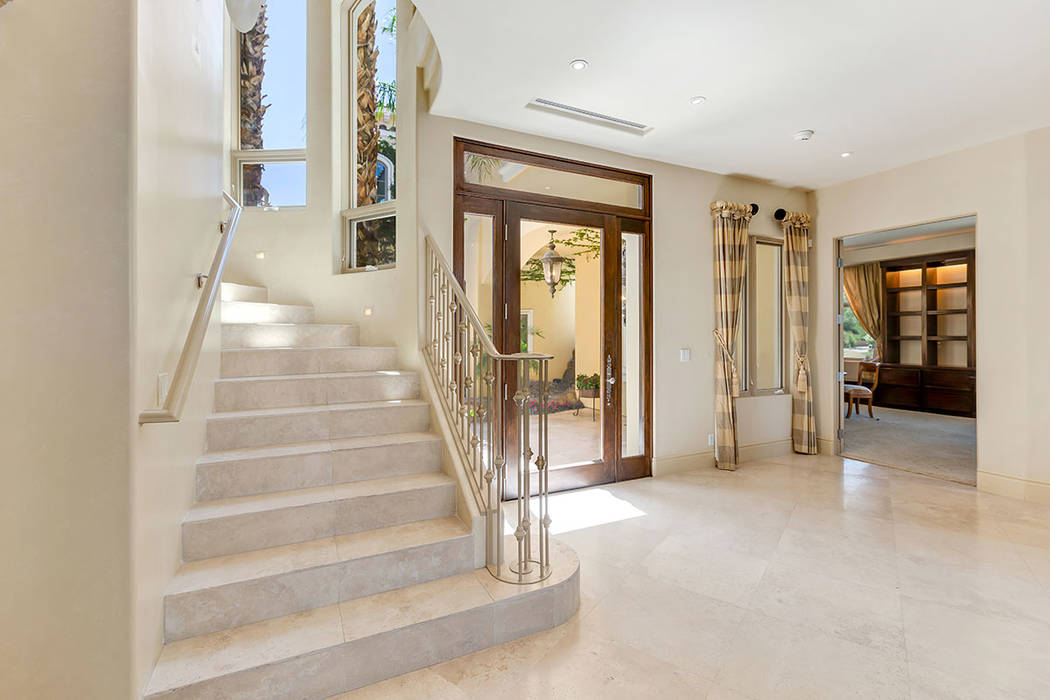 The stairs is off the entrance to the home. (Ivan Sher Group)