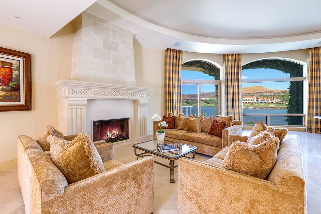 The living room features a traditional fireplace. (Ivan Sher Group)