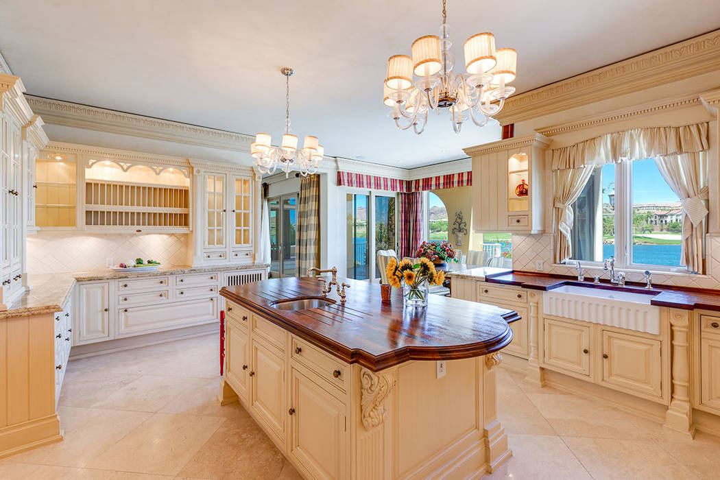 The kitchen features Christians custom cabinetry and mahogany countertops. (Ivan Sher Group)