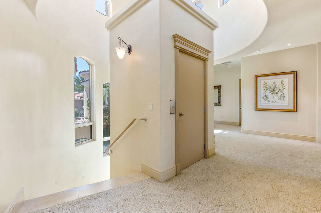 An elevator connects the two levels of the home. (Ivan Sher Group)