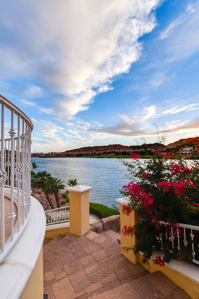 A stone staircase that's lined with palms and bougainvillea leads from the home to the dock. ...
