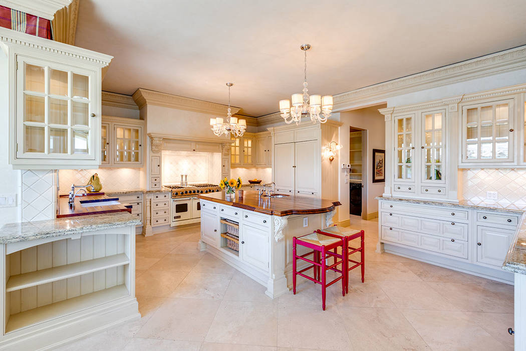 The kitchen's Christians custom cabinetry lend to a traditional country estate aesthetic. (Iv ...