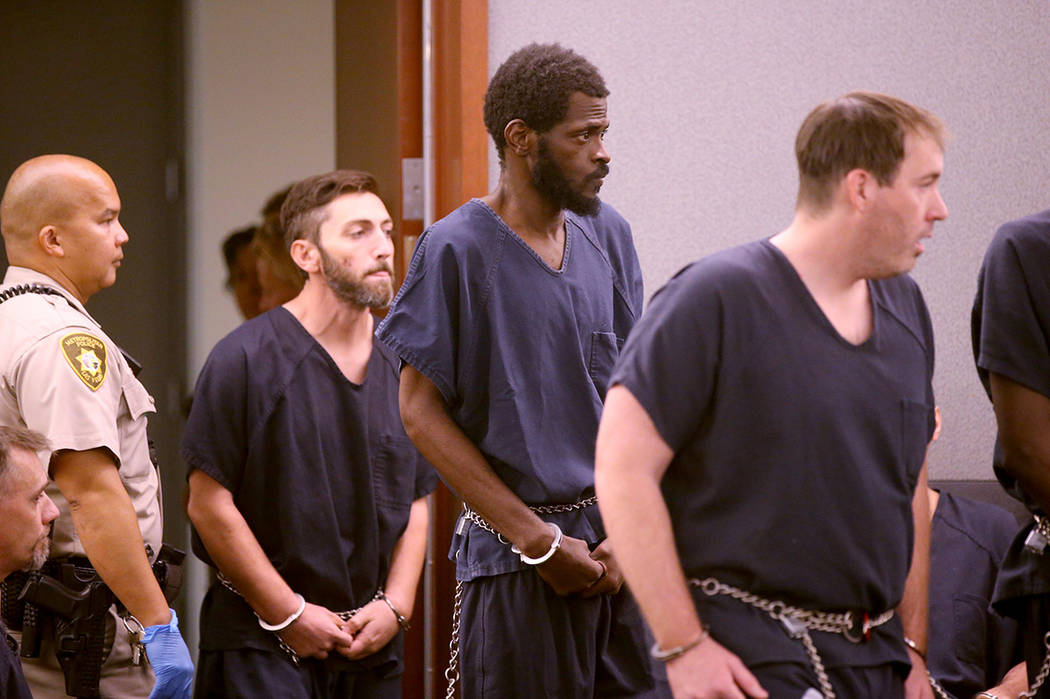Clinton Taylor, center, appears in court at the Regional Justice Center in Las Vegas Wednesday, ...