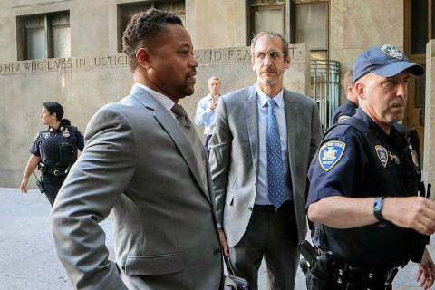 Cuba Gooding, Jr., left, arrives at court to face a groping allegation charge, Tuesday Sept. 3, ...
