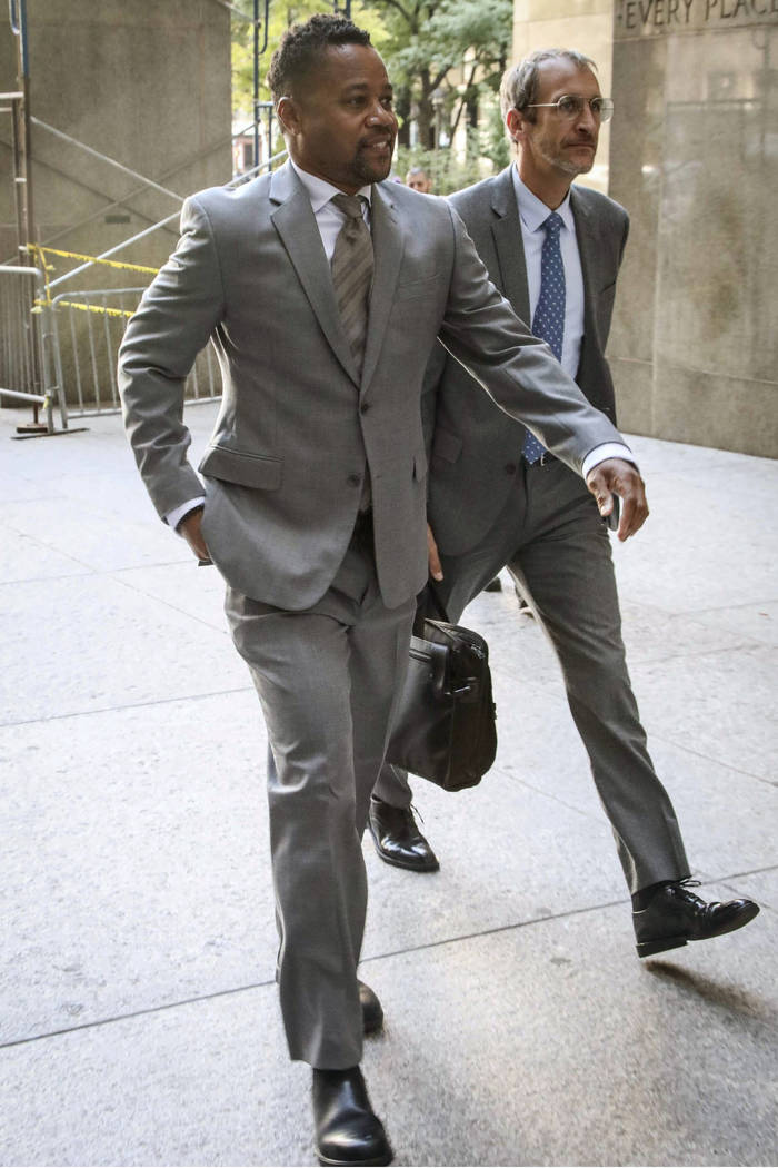 Cuba Gooding, Jr. left, arrives at court as he faces a groping allegation charge, Tuesday, Sept ...