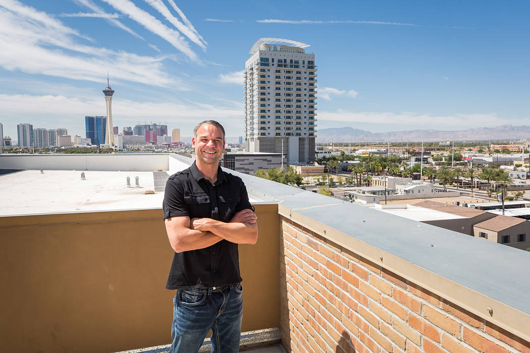 Joe Van Dusen, a commercial airline pilot, enjoys the view from his balcony at Juhl, a loft-sty ...