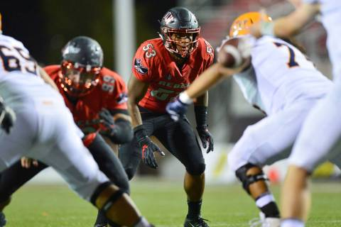 UNLV Rebels linebacker Farrell Hester II (53) stares down a running back during a game against ...