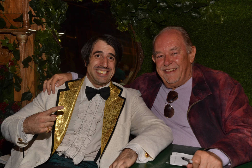 """The Gazillionaire, left, is shown with Robin Leach at an """"Absinthe"""" anniversary at Caesars Pala ..."""