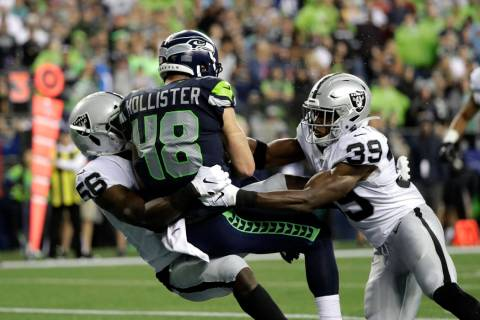 Seattle Seahawks tight end Jacob Hollister (48) scores a touchdown after a reception as he is t ...