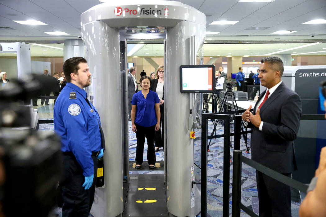 Jose Bonilla, director of Transportation Security Administration Innovation Task Force, right, ...