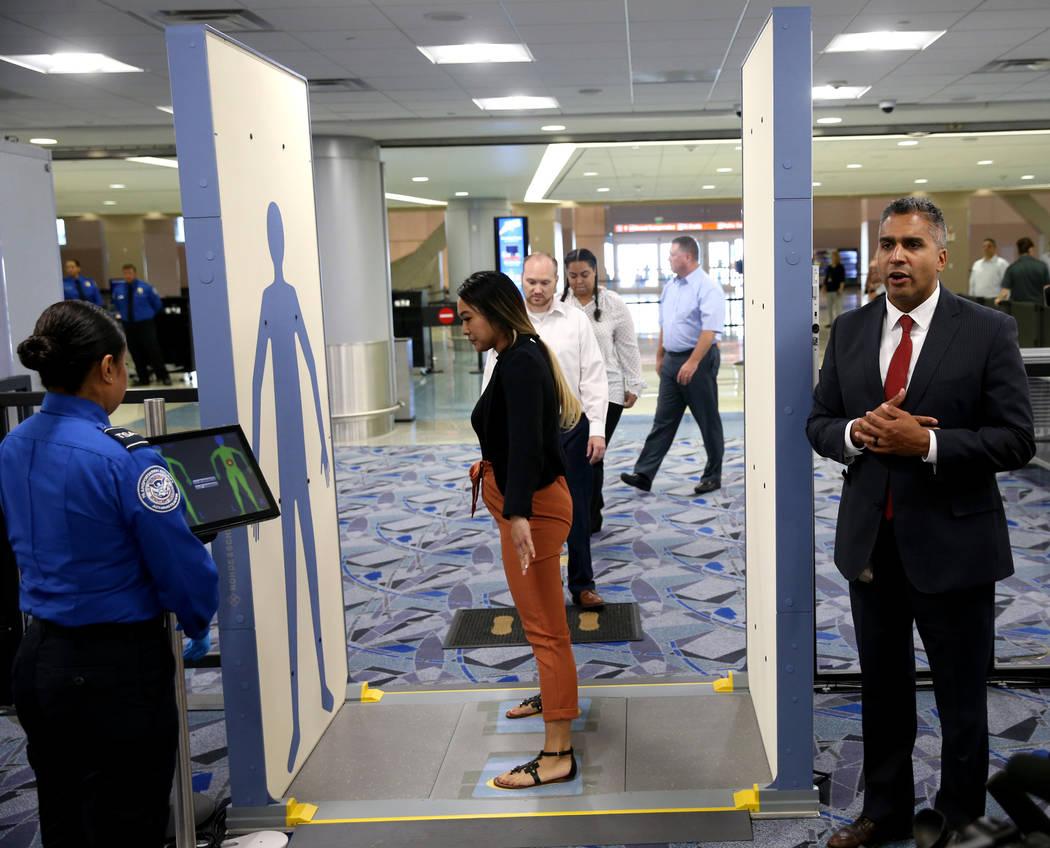 Jose Bonilla, director of Transportation Security Administration Innovation Task Force, right, ...