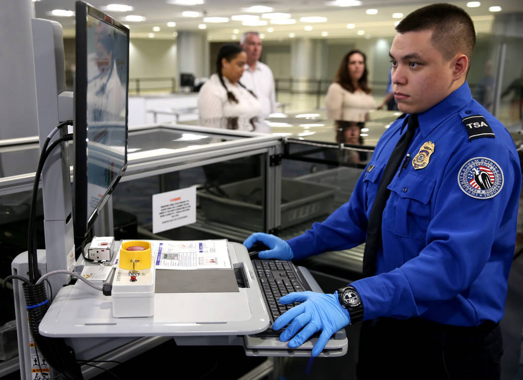 Transportation Security Officer Duenas demonstrates a 3D scanner during an announcement for the ...