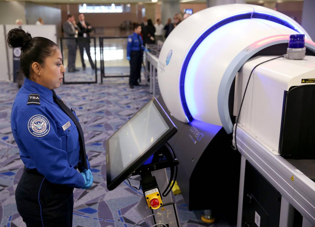 Transportation Security Officer Sanchez Gonzalez demonstrates a 3D scanner during an announceme ...