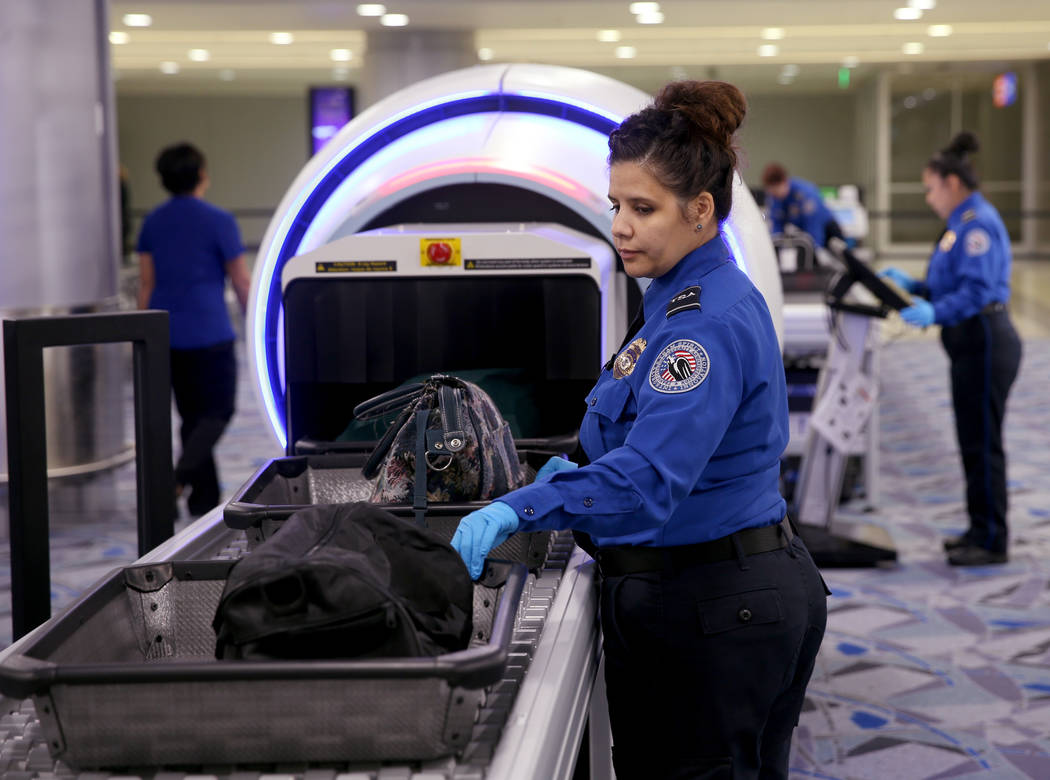 Transportation Security Officer Aguayo demonstrates a 3D scanner during an announcement for the ...